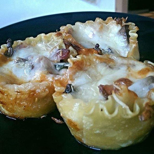 Pancetta lasagna cupcakes! Lined and layered with noodles, red sauce, white sauce, spinach, pancetta and mozzarella/parmesan. .